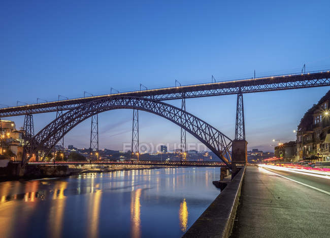 Illuminated Dom Luis I Bridge and Douro River at dusk, Porto, Portugal, Europe — Stock Photo