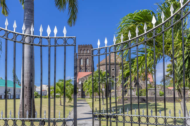 View of Saint George with Saint Barnabas Anglican Church behind gate, Basseterre, St. Kitts and Nevis, West Indies, Caribbean, Central America — Stock Photo