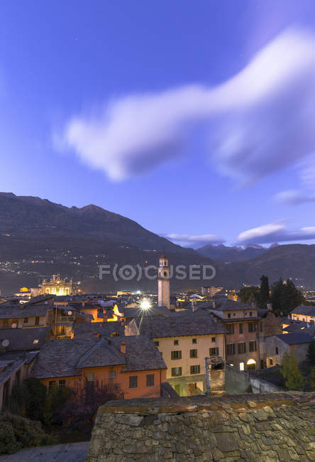 City of Morbegno in mountains at dusk, Valtellina, Lombardy, Italy, Europe — Stock Photo
