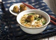 Noodle soup with crab dumplings — Stock Photo