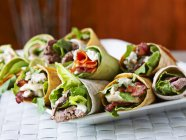 Closeup view of various wraps with vegetables and meat — Stock Photo