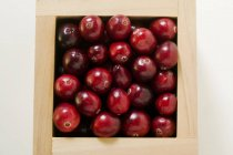 Cranberries in wooden box — Stock Photo