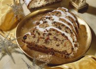 Butter stollen with almonds and candied fruits — Stock Photo