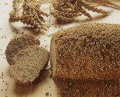 Wholemeal wheat bread with sesame crust — Stock Photo