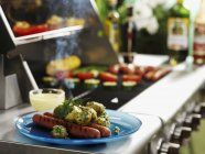 Sausages with dill potatoes — Stock Photo