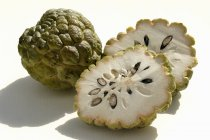 Whole sugar-apple and two halves — Stock Photo