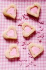 Heart-shaped biscuits with pink icing — Stock Photo