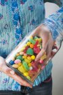 Hand taking sweets — Stock Photo