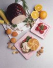 Elevated view of sandwich with turkey on cutting board and strawberries — Stock Photo