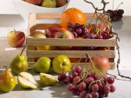 Fresh fruits with wooden box — Stock Photo