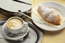 Caffe crema and croissant — Stock Photo