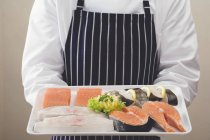 Tray of salmon and sea bass pieces — Stock Photo