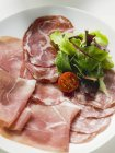 Raw ham and salami — Stock Photo