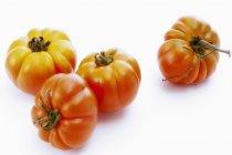 Quatre tomates beefsteak — Photo de stock