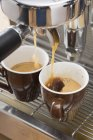 Making espresso with coffee machine — Stock Photo