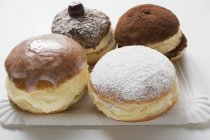 Vier verschiedene Donuts — Stockfoto