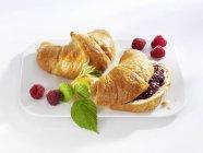 Croissants, plain and jam — Stock Photo