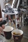 Human hand Making espresso — Stock Photo