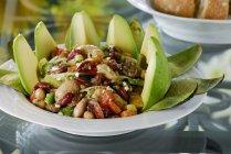 Bean salad with avocado on white plate — Stock Photo