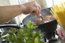Chef cooking meat — Stock Photo