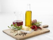 Still life with oil, vinegar, spices and vegetables — Stock Photo