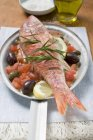 Fried red mullet on Mediterranean vegetables — Stock Photo