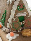 Gingerbread house with people — Stock Photo