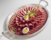 Salami platter with eggs — Stock Photo