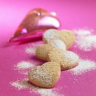 Almond hearts sprinkled with icing sugar — Stock Photo