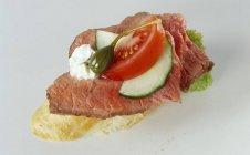 Roast beef on baguette — Stock Photo