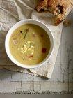 Creamy sweetcorn soup in white bowl — Stock Photo