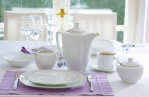 Place-setting with white tea things — Stock Photo