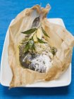 Roasted sea bream with herbs — Stock Photo