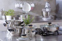 Assorted stainless steel pans in a kitchen — Stock Photo