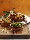 Green olives in bowls — Stock Photo