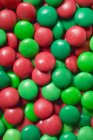 Closeup view of red and green chocolate beans — Stock Photo