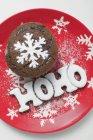Magdalena de chocolate y la palabra HOHO - foto de stock