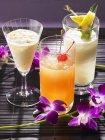Closeup view of Pina Colada with Mai Tai and Batida de Maracuja cocktails — Stock Photo