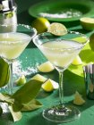 Margaritas with salted rim and slices of lime — Stock Photo