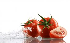 Tomatoes surrounded with water — Stock Photo