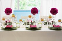 A festively laid table with flower balls — Stock Photo