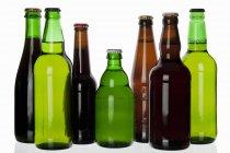 Various types of beer in bottles — Stock Photo