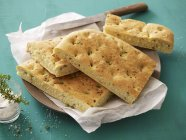 Closeup view of Focaccia with salt and thyme — Stock Photo