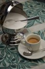 Cup of espresso and sugar pot — Stock Photo