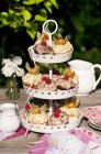 Various cupcakes on cake stand — Stock Photo