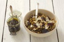 Spaghetti with purple basil pesto — Stock Photo