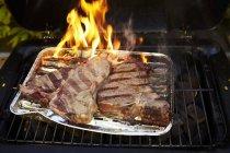 T-bone steak in tray — Stock Photo
