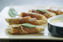 Saltimbocca  on white plate — Stock Photo