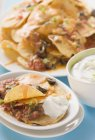 Tortilla chips with melted cheese — Stock Photo
