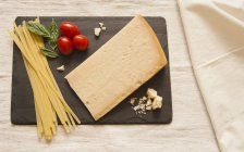 Parmesan cheese with dried pasta — Stock Photo